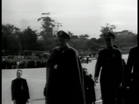 president of republic of china chiang kaishek walking up steps from car ms military soldiers at attention one blowing bugle ws soldiers doing... - chiang kai shek stock-videos und b-roll-filmmaterial