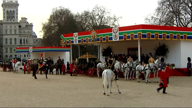 ceremonial welcome on horse guards parade royal horsedrawn carriage by podium / zoom in to queen elizabeth in back of carriage - horse guards parade stock videos and b-roll footage