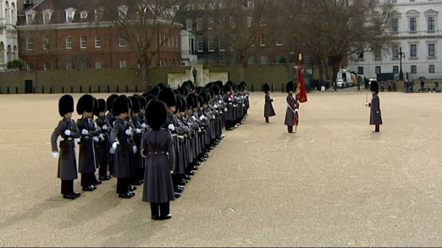 ceremonial welcome on horse guards parade miltary guard of honour marching towards saluting soldier / guard of honour stands to attention / military... - guard of honour stock videos and b-roll footage