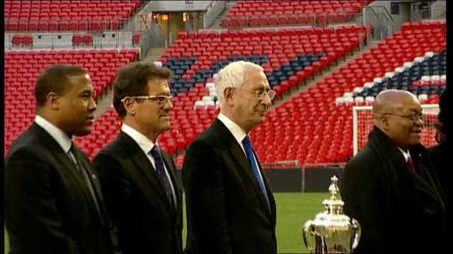 president of south africa visits wembley stadium during day two of state visit england london wembley stadium ext jacob zuma and lord triesman... - aaron mokoena stock videos & royalty-free footage