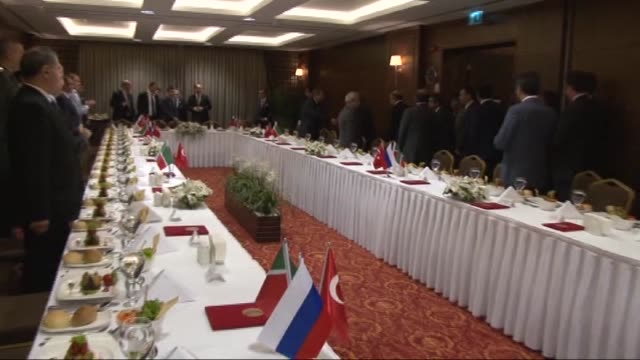 President of the Republic of Tatarstan Rustam Minnikhanov is welcomed by Turkish Science Industry and Technology Minister Fikri Isik during a dinner...