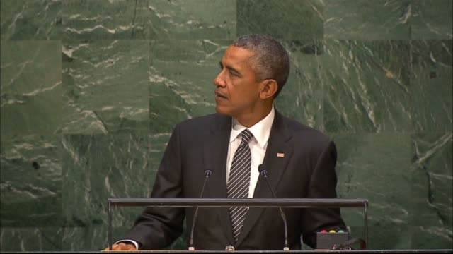 president of the united states barack obama speaks during the 2015 sustainable development summit in new york on september 27 at united nations... - 国際連合点の映像素材/bロール