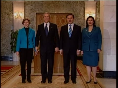 president of the united states, george w. bush and the president of mongolia nambaryn enkhbayar shake hands and pose for photos with their wives... - independent mongolia stock videos & royalty-free footage