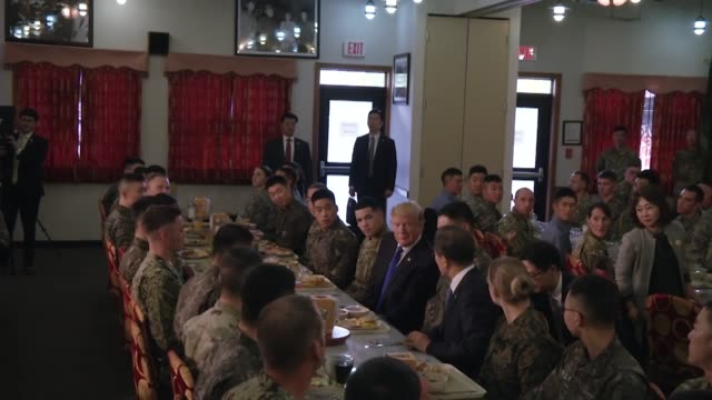 president of the united states of america donald trump visits army camp in south korea where he sits with soldiers and gives short lunchtime speech - bodyguard stock videos & royalty-free footage