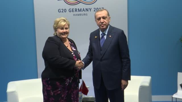 President of Turkey Recep Tayyip Erdogan meets with Norwegian Prime Minister Erna Solberg during the G20 Leaders' Summit in Hamburg Germany on July...