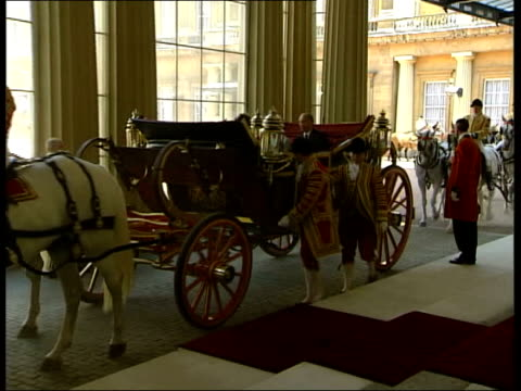 president putin begins state visit pool lms queen elizabeth ii and president putin along in open carriage to palace pan gv guards and gun carriages... - state visit stock videos & royalty-free footage