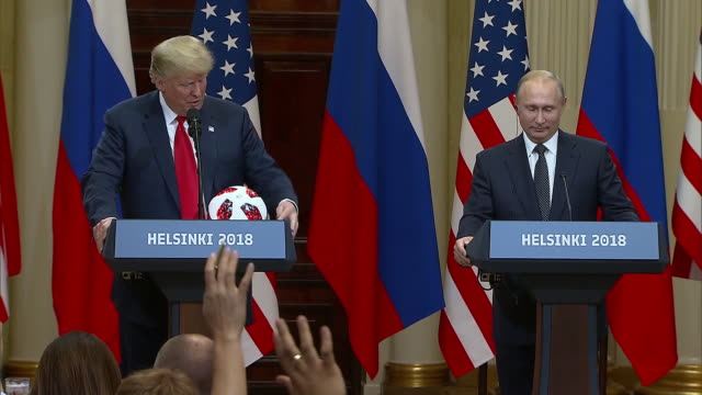 stockvideo's en b-roll-footage met president putin gives president trump a football to celebrate the us hosting of the 2026 fifa world cup during the trump putin summit on july 16 2018 - business or economy or employment and labor or financial market or finance or agriculture