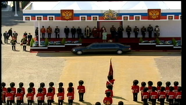 arrival and guard of honour / carriage ride with queen england london horse guards parade cars along vladimir putin wife out of car greeted by the... - jack straw stock videos & royalty-free footage