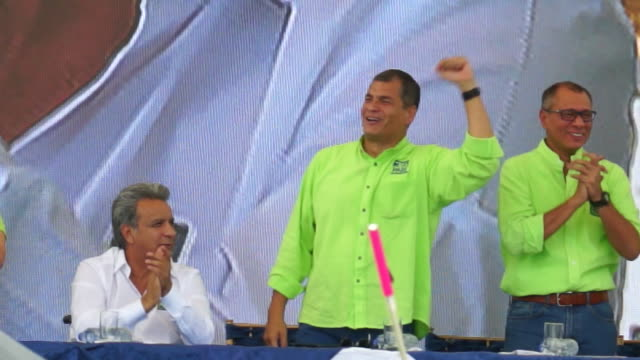 President Rafael Correa vice president Jorge Glas and candidate of Ecuador ruling political party Lenin Moreno wave to public during national...