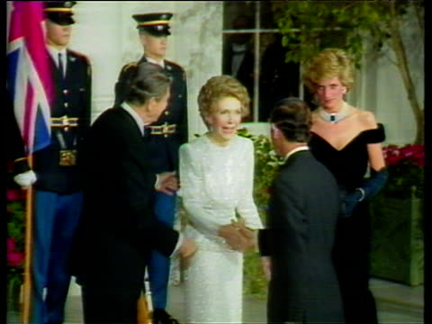 stockvideo's en b-roll-footage met president reagan and wife nancy greet prince charles and princess diana outside white house washington dc 10 nov 85 - ronald reagan amerikaans president