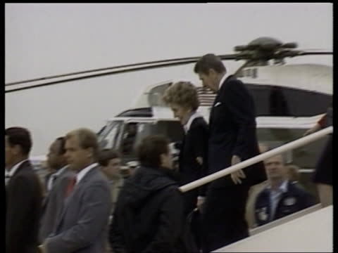 president reagan london stopover england lap president ronald reagan and wife nancy wave from top of aircraft steps ms side reagans down plane steps... - president stock videos & royalty-free footage