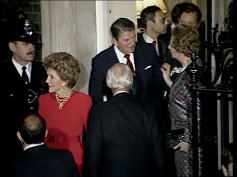 president reagan london stopover england london no 10 downing st ms nancy reagan wife of us president waves from doorway zoom in as embraces pm's... - ronald reagan präsident der usa stock-videos und b-roll-filmmaterial