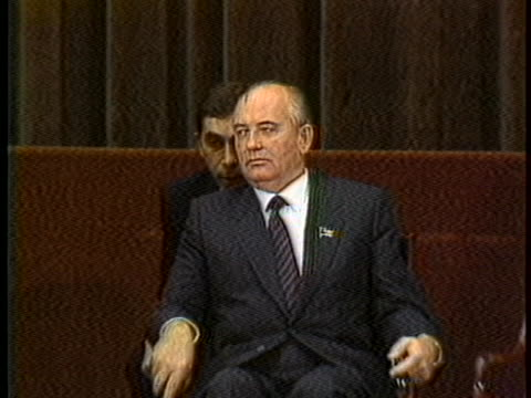 president reagan speaks in front of world political leaders at the geneva summit while mikhail gorbachev listens and nods. - russian flag stock videos & royalty-free footage