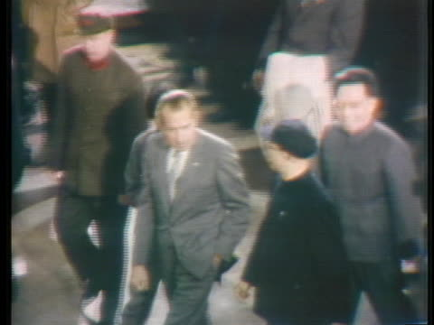 president richard m. nixon and chinese officials tour the shanghai industrial exhibition during nixon's visit to china. - 1972年点の映像素材/bロール