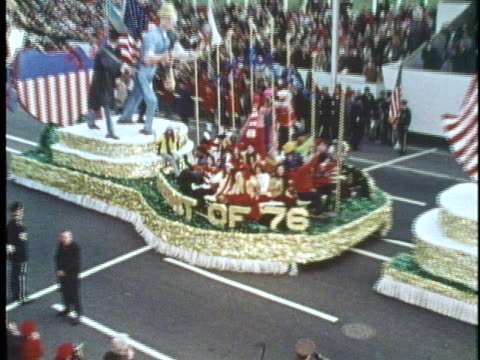 us president richard m nixon watches as the inaugural parade in his honor passes by the viewing booth on january 20 1973 - präsident stock-videos und b-roll-filmmaterial