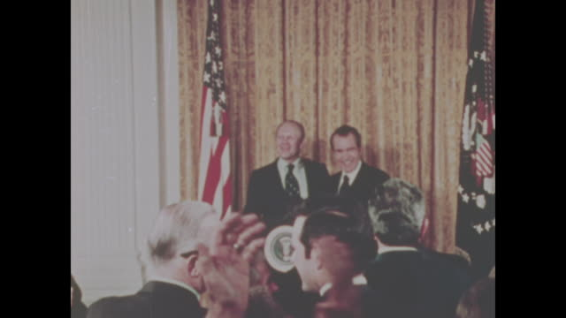 vídeos de stock, filmes e b-roll de president richard nixon and gerald ford stand together after nixon's announcement that ford was his choice for vice president, replacing spiro agnew. - richard nixon