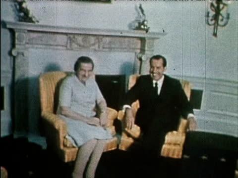 president richard nixon and israeli prime minister golda meir sit together at white house - 月経前緊張症候群点の映像素材/bロール