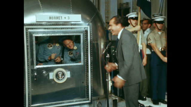 president richard nixon greets apollo 11 astronauts from outside of their mobile quarantine facility. - produced segment stock videos & royalty-free footage