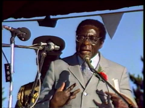 president robert mugabe on stage at political rally; 1980s - political rally stock videos & royalty-free footage
