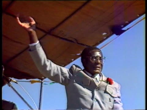 President Robert Mugabe waves to crowd at campaign rally 1980s