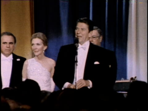 US President Ronald Reagan addresses attendees at the inaugural ball at the Washington Hilton Hotel