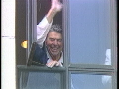 president ronald reagan and wife, nancy, wave from hospital windows shortly after the 1981 assassination attempt. - anno 1981 video stock e b–roll