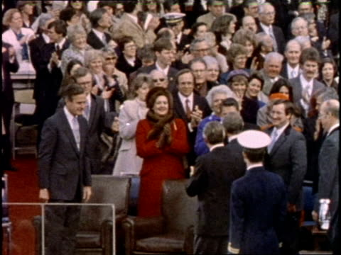 vídeos de stock, filmes e b-roll de us president ronald reagan arrives for his inauguration ceremony on january 20 1981 - tomada de posse