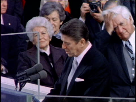 vídeos de stock, filmes e b-roll de us president ronald reagan delivers his inauguration speech on january 20 1981 - tomada de posse