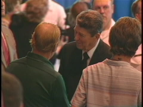 president ronald reagan shakes hands and consoles family members of those killed when a missile strike hit the uss stark. - transparent stock videos & royalty-free footage
