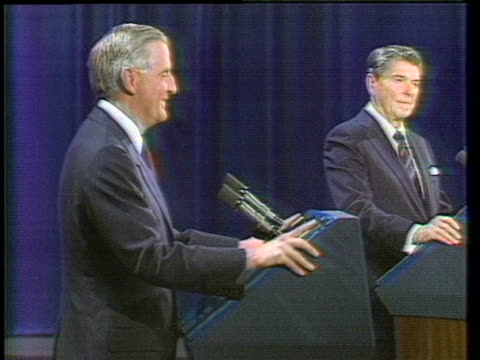 president ronald reagan speaks at a podium as presidential candidate walter mondale looks on. - 討論点の映像素材/bロール