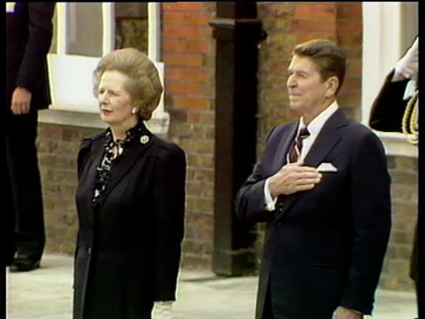 president ronald reagan with hand on heart standing next to prime minister margaret thatcher as american national anthem is played at kensington... - conservative party uk stock videos and b-roll footage