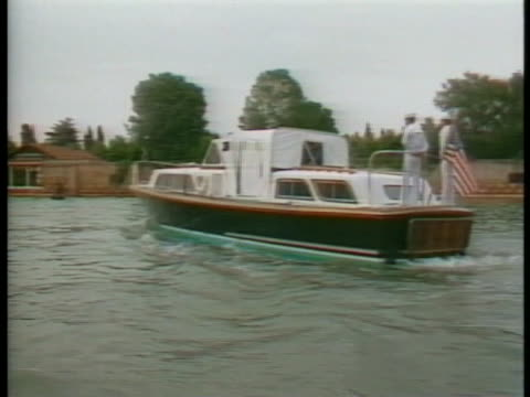 us president ronald reagan's boat cruises down the grand canal in venice - business or economy or employment and labor or financial market or finance or agriculture video stock e b–roll