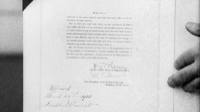 President Roosevelt dips pen in ink and signs the CullenHarrison Act amending prohibition law to allow for sale of beer and wine with an alcohol...