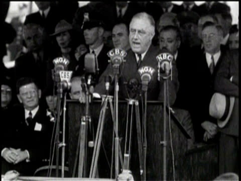 president roosevelt finishes his speech / the crowds cheer - 1937 stock-videos und b-roll-filmmaterial