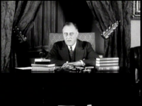 vídeos y material grabado en eventos de stock de president roosevelt sits a desk in front of large window drapes closed / speaks about a new law to issue currency / - franklin roosevelt