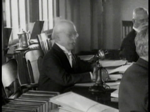 president samuel gompers at head of table talking. gompers at table handing paper to man other members. - other stock videos & royalty-free footage