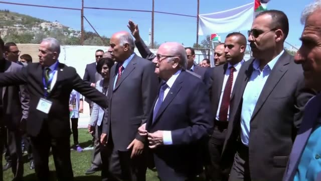 president sepp blatter and president of palestinian football federation and the palestine olympic committee jibril rajoub attend ribbon cutting... - fifa stock videos & royalty-free footage