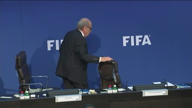 president sepp blatter showered in fake money by prankster; switzerland: zurich: fifa hq: int sepp blatter at press conference as interrupted by... - fifa stock videos & royalty-free footage