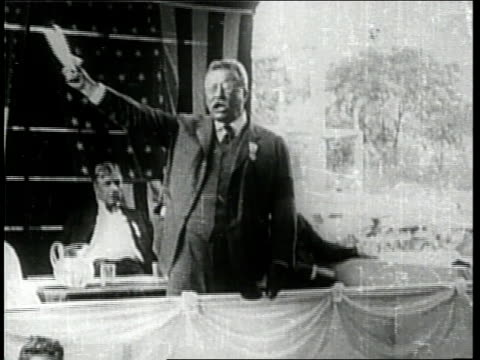 US President Theodore Roosevelt makes a speech while standing on a platform