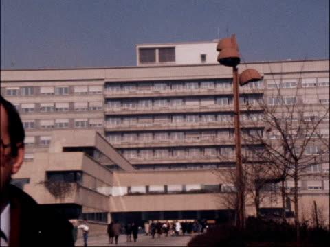 president tito's health deteriorates yugoslavia ljubljana ext clinic where josip broz tito being cared for pull out reporter to camera - 旧ユーゴスラビア点の映像素材/bロール