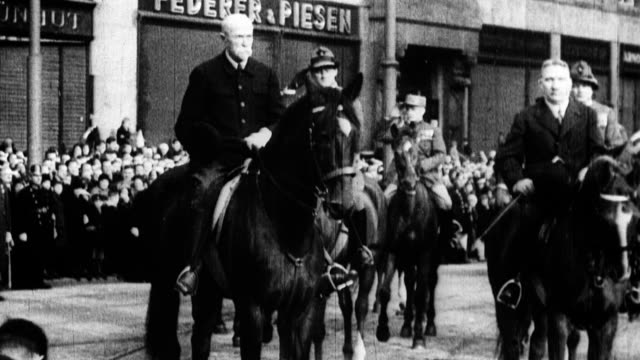 president tomas garrigue masaryk and czech minister of war on horses with crowd around them / president leads a parade down the streets of prague... - 1933 stock videos & royalty-free footage