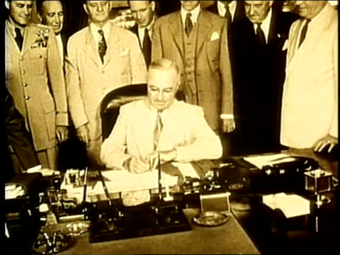 president truman signs executive order 9981 at desk, a bill to racially integrate the military / military advisors stand in bg. truman signs military... - harry truman stock videos & royalty-free footage