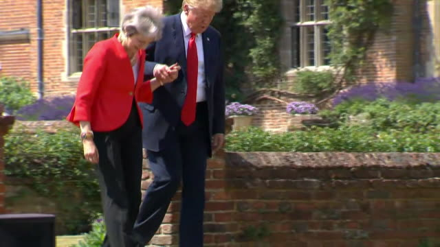 president trump and british prime minister theresa may briefly hold hands as they walk to the news conference at chequers in buckinghamshire, united... - (war or terrorism or election or government or illness or news event or speech or politics or politician or conflict or military or extreme weather or business or economy) and not usa stock videos & royalty-free footage