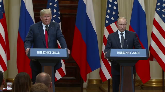 stockvideo's en b-roll-footage met president trump and president putin on the claim that russia has incriminating information on president trump during the trump putin summit on july... - (war or terrorism or election or government or illness or news event or speech or politics or politician or conflict or military or extreme weather or business or economy) and not usa