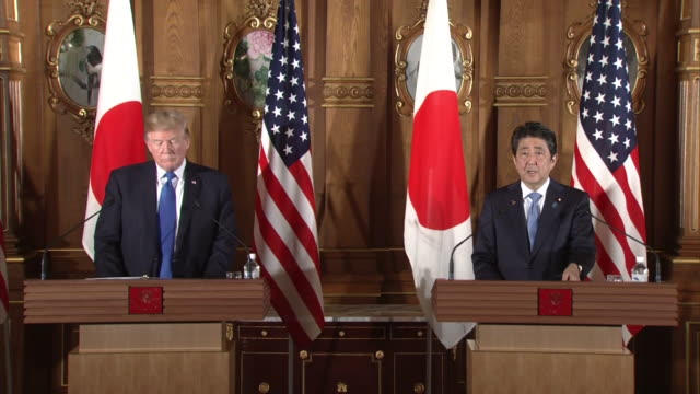 """president trump and prime minister abe enters room for japanus joint press conference abe saying """"the us president's asia tour is a historic visit... - north pacific stock videos and b-roll footage"""