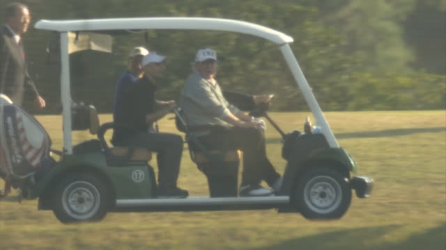 president trump and prime minister abe playing golf at kasumigaseki country club in kawagoe city, saitama. abe driving the golf cart. trump leaving... - golf cart stock videos & royalty-free footage