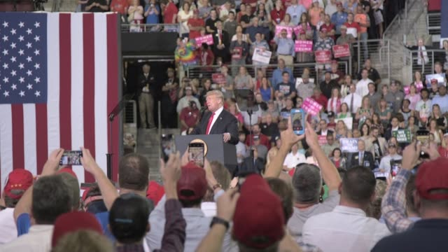 president trump applauds supporters as he arrives on stage wide of trump supporters cheering president trump close ups of trump supporters trump... - wide stock videos & royalty-free footage