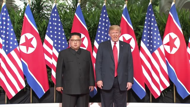 president trump shakes hands with kim jong un of north korea at the start of the north korea-united states summit on june 12, 2018. - singapore stock videos & royalty-free footage