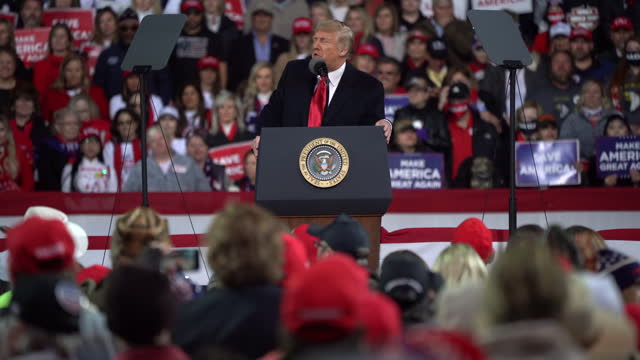 president trump speaking during his rally for senate runoff election for david perdue and kelly loeffler in valdosta, ga, u.s. on sunday, december 6,... - lectern stock videos & royalty-free footage