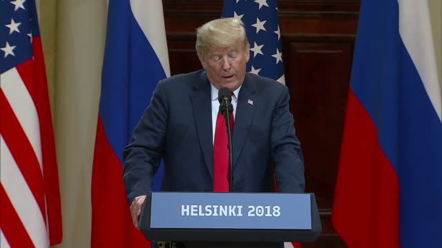 stockvideo's en b-roll-footage met president trump speaks about addressing the issue of russian interference during the election with president putin during the trump putin summit on... - business or economy or employment and labor or financial market or finance or agriculture